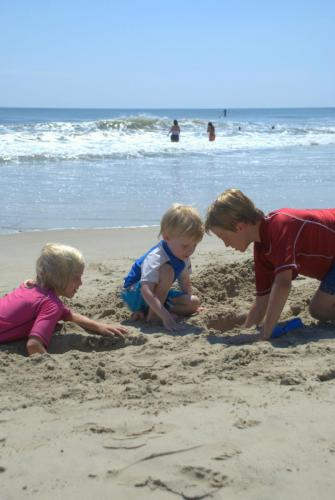 Youths building sand castles