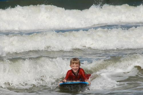 Child body surfing